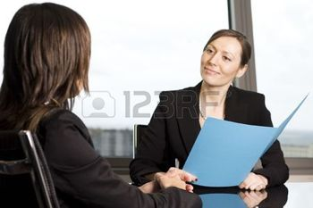 5257774-young-woman-having-a-job-interview-in-a-beautiful-office